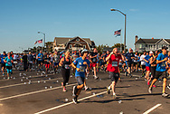 Spring Lake, NJ, USA -- May 27, 2017. Marathon Runners Discard Water Cups as they Carry on with the Race