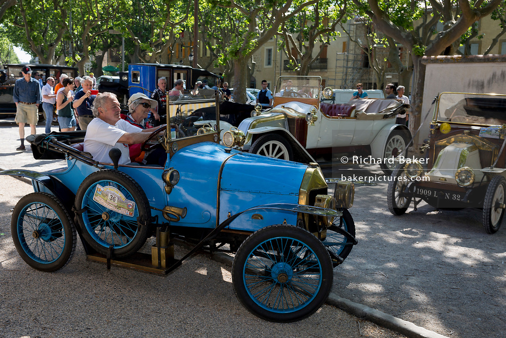 A visiting vintage car in the centre of a French village, during a three-day rally journey through the Corbieres wine region, on 26th May, 2017, in Lagrasse, Languedoc-Rousillon, south of France. Lagrasse is listed as one of France's most beautiful villages and lies on the famous Route 20 wine route in the Basses-Corbieres region dating to the 13th century.