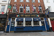 The French House pub on 19th October 2015 in London, United Kingdom. Situated in the busy area of Dean Street in Soho, the Grade II listed French House was reputedly the unofficial HQ of the free French in London during WWII.