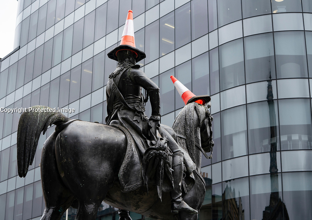 Famous Duke of Wellington statue with traffic cones on head in Royal Exchange Square, Glasgow, Scotland, UK