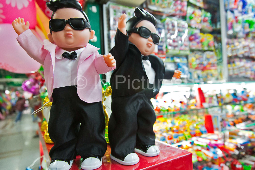 Dancing plastic dolls of Korean singer Psy stand in a toy shop at the China Commodity City in Yiwu, Zhejiang Province, China on 06 March  2013. The city of Yiwu is known as one of China's largest trading centers for small merchandise and light industry, drawing buyers from around the world. Uncertain global demand, a stronger yuan currency and rising labour costs have taken their toll on Chinese exporters, but analysts believe sales could pick up modestly in 2014 due to improved demand from the United States and Europe.