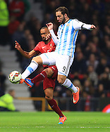 Gonzalo Higuain of Argentina and Jose Bosingwa of Portugal in action - Argentina vs. Portugal - International Friendly - Old Trafford - Manchester - 18/11/2014 Pic Philip Oldham/Sportimage