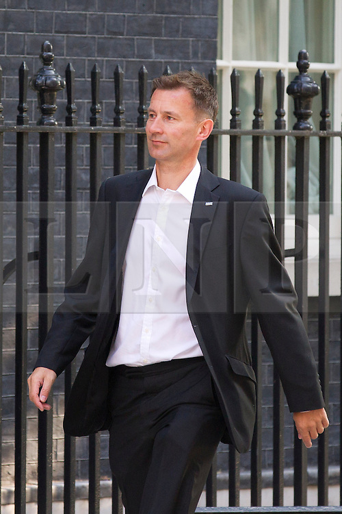 """© Licensed to London News Pictures. 29/08/2013. London, UK. The Health Secretary Jeremy Hunt arrives for a meeting of the British cabinet on Downing Street in London today (29/08/2013) as a recalled British Parliament prepares to debate the possibility of """"direct"""" military action over recent reports an alleged chemical weapons attack in Syria. Photo credit: Matt Cetti-Roberts/LNP"""