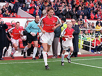 Tony Adams leads out the Arsenal team with the Mascot for the day. Arsenal v Aston Villa. FA Premiership, 14/10/00. Credit: Colorsport.