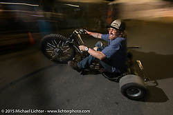 "Austin Andrella racing around in his custom ""Drifting Trike"" at the Cackleberry Campground Chop-In Block area during Daytona Beach Bike Week, FL, USA. Thursday, March 12, 2015.  Photography ©2015 Michael Lichter."