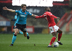 Fleetwood Town's Jack Sowerby (left) holds back Charlton Athletic's Mark Marshall