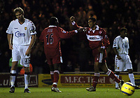 Fotball<br /> Premier League England 2004/2005<br /> Foto: SBI/Digitalsport<br /> NORWAY ONLY<br /> <br /> Middlesbrough v Aston Villa<br /> Barclays Premiership, 18/12/2004.<br /> <br /> Middlesbrough's Michael Reiziger celebrates with Joseph Desire Job after scoring, as Aston Villa's Olof Mellberg (L) shows his disappointment.