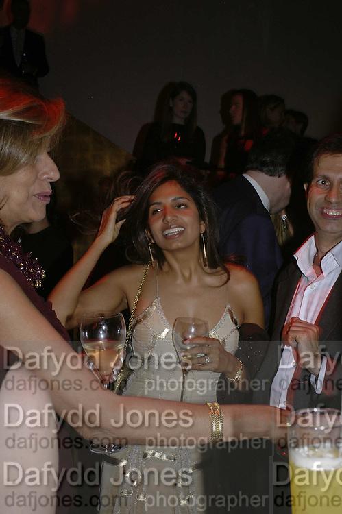 Mrs. Vimla Lalvani and Divia Lalvani, DONNA KARAN GOLD FRAGRANCE COLLECTION LAUNCH <br />IN BENEFIT OF ïOVER THE WALL, Donna Karan shop. New Bond St. London. 16 November 2006. ÍONE TIME USE ONLY - DO NOT ARCHIVE  © Copyright Photograph by Dafydd Jones 66 Stockwell Park Rd. London SW9 0DA Tel 020 7733 0108 www.dafjones.com