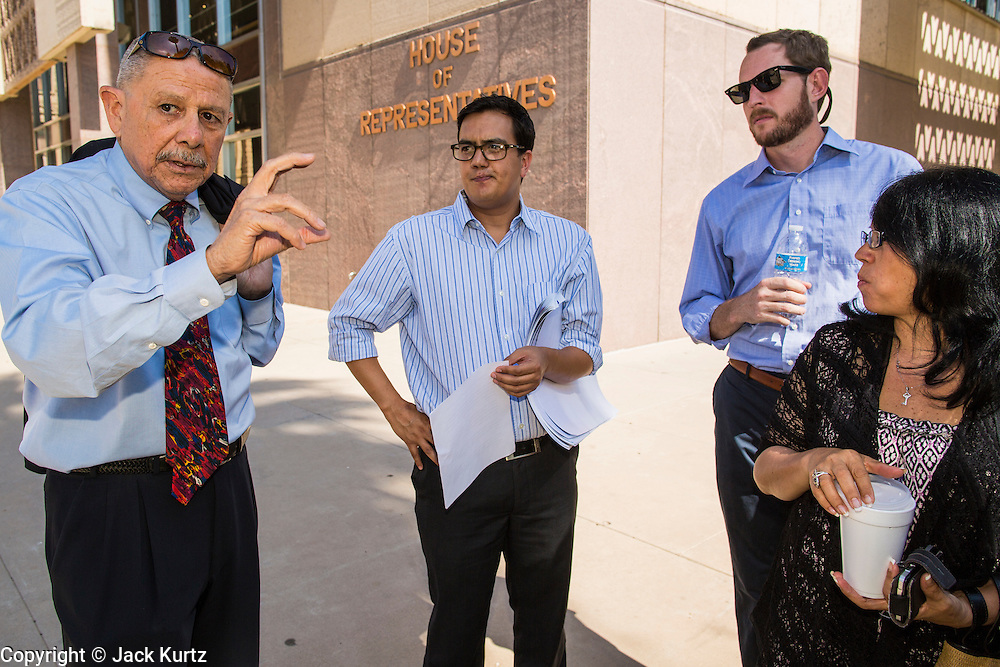 25 JUNE 2012 - PHOENIX, AZ:   Former Arizona legislator ALFREDO GUTIERREZ (left) talks to other Latino political leaders at the state capitol Monday after the US Supreme Court's ruling that overturned SB1070. The case, US v. Arizona, determined whether or not Arizona's tough anti-immigration law, popularly known as SB1070 is constitutional. The court struck down most of the law but left one section standing, the section authorizing local police agencies to check the immigration status of people they come into contact with.    PHOTO BY JACK KURTZ