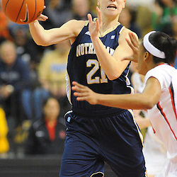 Notre Dame Fighting Irish guard Natalie Novosel (21) passes the ball past Rutgers Scarlet Knights guard Briyona Canty (25) during first half NCAA Big East women's basketball action between Notre Dame and Rutgers at the Louis Brown Athletic Center. Notre Dame leads 40-23 at halftime.