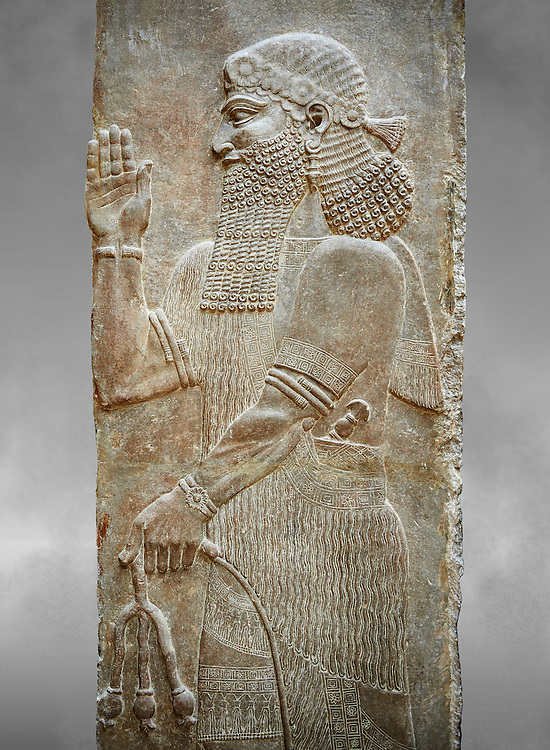 Stone relief sculptured panel of a man holding poppy seed pods. Facade N. Inv AO 19870 from Dur Sharrukin the palace of Assyrian king Sargon II at Khorsabad, 713-706 BC.  Louvre Museum Room 4 , Paris .<br /> <br /> If you prefer to buy from our ALAMY PHOTO LIBRARY  Collection visit : https://www.alamy.com/portfolio/paul-williams-funkystock/ancient-assyria-antiquities.html  Refine search by adding background colour, place, subject, museum etc into the LOWER SEARCH WITHIN GALLERY box to <br /> <br /> Visit our ANCIENT ASSYRIAN PHOTO COLLECTIONS for more photos to download or buy as wall art prints https://funkystock.photoshelter.com/gallery-collection/Ancient-Assyrian-Art-Artefacts-Antiquities-Historic-Sites-Pictures-Images-of/C0000cjRqQyJjLag