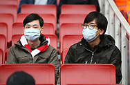 Arsenal fans wear protective face masks during the Premier League match at the Emirates Stadium, London. Picture date: 7th March 2020. Picture credit should read: Paul Terry/Sportimage