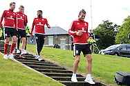 Gareth Bale of Wales ® leads his teammates to the Wales football team training session at the Vale Resort, Hensol Castle near Cardiff ,South Wales on Monday 31st August  2015. The team are preparing for their next EURO 2016 qualifying match away to Cyprus later this week.<br /> pic by Andrew Orchard, Andrew Orchard sports photography.