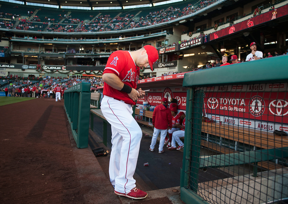 The Angels' Daniel Nava signs autographs before the Angels' 5-4 loss to the Oakland Athletics at Angel Stadium on Thursday.<br /> <br /> ///ADDITIONAL INFO:   <br /> <br /> angels.0624kjs  ---  Photo by KEVIN SULLIVAN / Orange County Register  --  6/23/16<br /> <br /> The Los Angeles Angels take on the Oakland Athletics Thursday at Angel Stadium.<br /> <br /> <br />  6/23/16