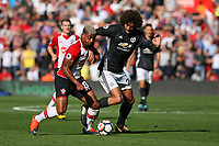 Football - 2017 / 2018 Premier League - Southampton vs. Manchester United<br /> <br /> Southampton's Mario Lemina holds Marouane Fellaini of Manchester United off the ball at St Mary's Stadium Southampton<br /> <br /> COLORSPORT/SHAUN BOGGUST