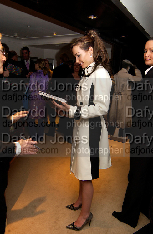 Terry O'Neill and Tara Palmer-Tompkinson, Terry O'Neill to celebrate his book, 'Celebrity' at Dunhill,  28 October 2003. © Copyright Photograph by Dafydd Jones 66 Stockwell Park Rd. London SW9 0DA Tel 020 7733 0108 www.dafjones.com