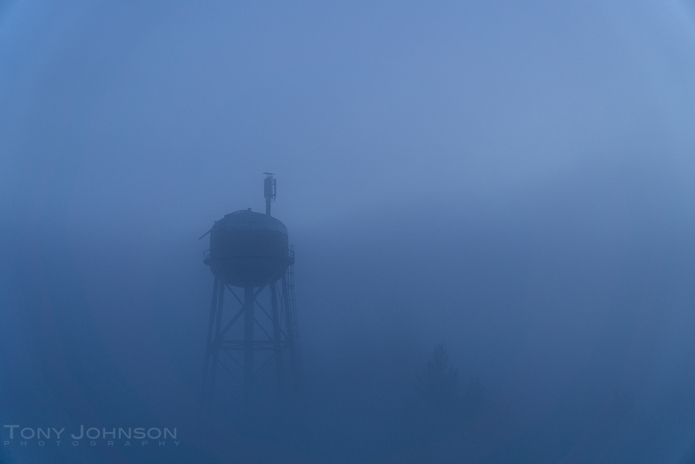 The Battle Point Park water tower appears through fog