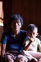Young boy with his grandmother in Nanga Sumpa Longhouse.