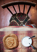 """Typical welcoming dish: """"Nan"""" (Flatbread) and fresh yoghurt from the high pasture. Tusion village.<br /> The road and villages along the Shakhdara river.<br /> <br /> The town of Khorog (2200m), is the capital of the Gorno-Badakhshan Autonomous Province (GBAO) in Tajikistan. It is situated in the Pamir Mountains (ancient Mount Imeon) at the confluence of the Gunt and Panj rivers.<br /> The city is bounded to the south and to the north by the deltas of the Shakhdara and Gunt rivers, respectively. The two rivers merge in the eastern part of the city flow through the city, dividing it almost evenly until its delta in the river Panj, also being known as Amu Darya, or in antiquity the Oxus on the border with Afghanistan. Khorog is known for its beautiful poplar trees that dominate the flora of the city.<br /> Khorog is one of the poorest areas of Tajikistan, with the charitable organization Aga Khan Foundation providing almost the only source of cash income. Most of its inhabitants are Ismaili Muslims.<br /> <br /> Tajikistan, a mountainous landlocked country in Central Asia. Afghanistan borders it to the south, Uzbekistan to the west, Kyrgyzstan to the north, and People's Republic of China to the east. Tajikistan also lies adjacent to Pakistan separated by the narrow Wakhan Corridor.<br /> Tajikistan became a republic of the Soviet Union in the 20th century, known as the Tajik Soviet Socialist Republic.<br /> It was the first of the Central Asian republic to gain independence in December 1991."""