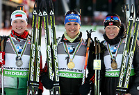 Skiskyting<br /> VM 2011<br /> Khanty Mansiysk Russland<br /> 12.03.2011<br /> Foto: Gepa/Digitalsport<br /> NORWAY ONLY<br /> <br /> IBU Weltmeisterschaften, 12,5km Massenstart der Damen, Siegerehrung. <br /> <br /> Bild zeigt Darya Domracheva (BLR), Magdalena Neuner (GER) und Tora Berger (NOR).