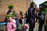 May Day custom of Deptford Jack in the Green, a man encased in a framework entirely covered with greenery, is one of the lesser-known modern revivals by the Blackheath Morris Men of English traditional customs on May 1st 2016 in London, United Kingdom. Fowlers Troop Jack in the Green was revived in the early 1980s. Originally a revival from about 1906, it developed from the 17th Century custom of milkmaids going out on May Day with the utensils of their trade, decorated with garlands of flowers and piled into a pyramid which they carried on their heads. By the mid eighteenth century other groups, notably chimney sweeps, were moving in on the milkmaids territory as they saw May Day as a good opportunity to collect money, so carried a Jack in the Green. Over the last 25 years several popular festivals have grown up around the Jack in the Green tradition. Deptford Jack in the Green is not very widely known although it has been running since the early 1980s.