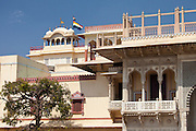 The Maharaja of Jaipur's Moon Palace with flags to show that Maharaja is in residence in Jaipur, Rajasthan, India