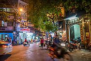 Night time street scene in the old quarter of Hanoi, Vietnam.
