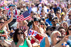 © Licensed to London News Pictures. 19/05/2018. London, UK. A woman in a cowboy hat waves the American flag as well-wishers watch the Royal Wedding at an outdoor screening at the National Maritime Museum in Greenwich. Prince Harry is getting married to Meghan Markle today in Windsor. Photo credit: Rob Pinney/LNP