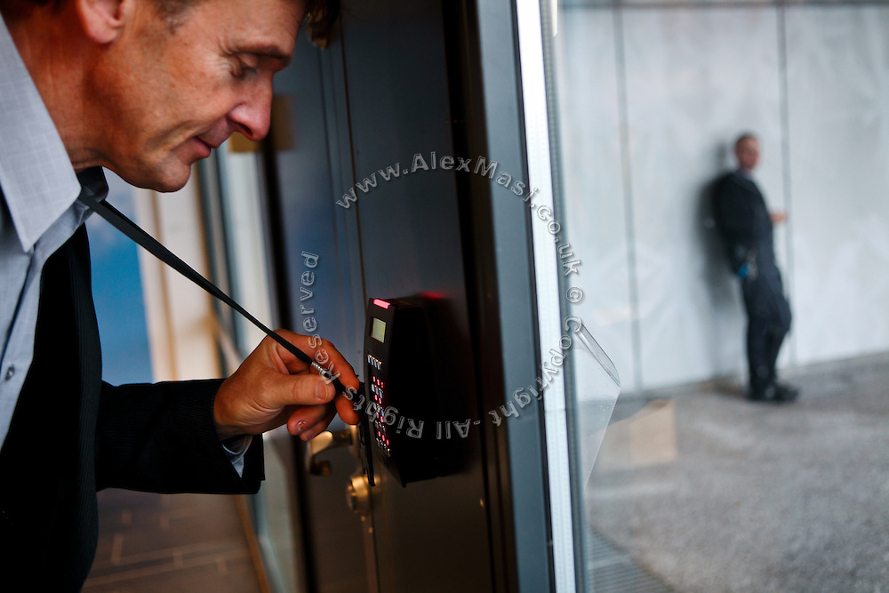 The school head-teacher is opening an exit door with his electronic badge in the luxurious Halden Fengsel, (prison) near Oslo, Norway.
