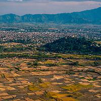 Open fields still stretch around Kathmandu, Nepal in 1986. Swayambhu Temple is atop the hill.6. Swayambhu Temple is atop the hill.