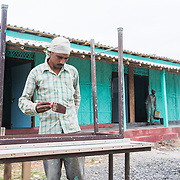CAPTION: Painting the finishing touches, as the DESI Mantra training centre is just days away from opening its doors to its first batch of trainees. LOCATION: Gayari, Araria District, Bihar, India. INDIVIDUAL(S) PHOTOGRAPHED: Mohammad Dawood.