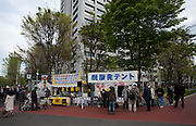 "Anti nuclear Occupy Kasumigaseki camp outside the METI building in Kasumigaseki, Tokyo, Japan. Friday April 12th 2013 The camp has been in place since September 2011 resisting several attempts to remove it. It now faces a court order restricting access and protestors have been served with a order to pay ""rent"" for their use of the land."
