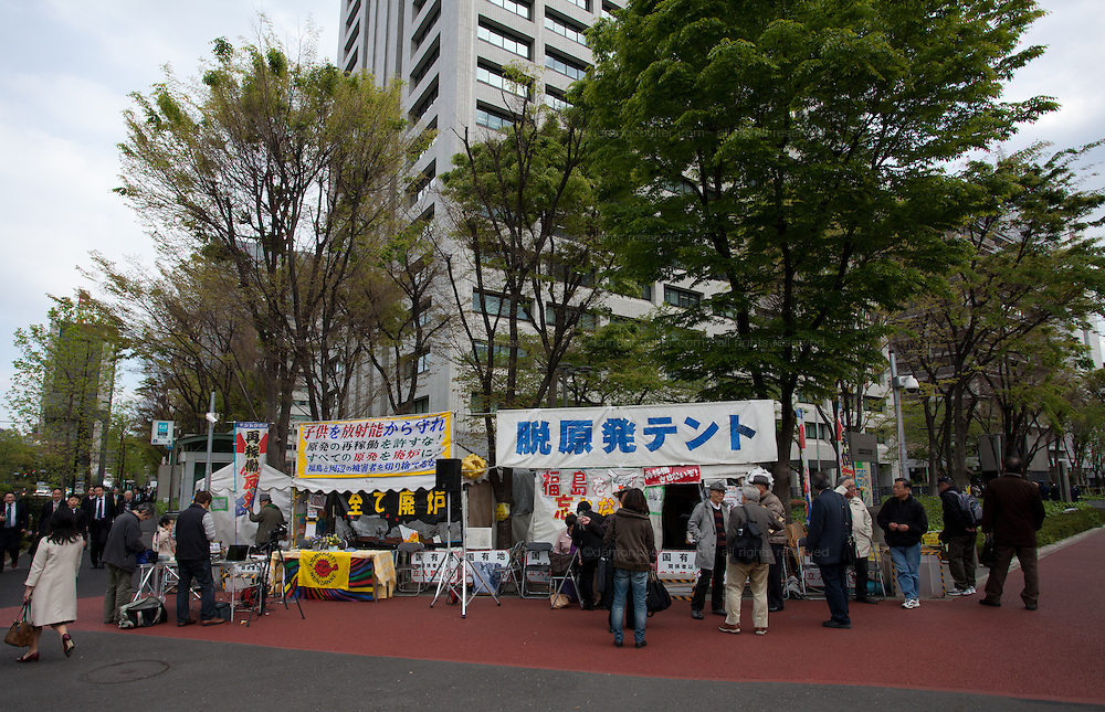 """Anti nuclear Occupy Kasumigaseki camp outside the METI building in Kasumigaseki, Tokyo, Japan. Friday April 12th 2013 The camp has been in place since September 2011 resisting several attempts to remove it. It now faces a court order restricting access and protestors have been served with a order to pay """"rent"""" for their use of the land."""