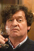 Comte (count) Laurent de Bosredon, owner of Chateau Belingard tasting his wine in the tasting room Chateau Belingard Bergerac Dordogne France