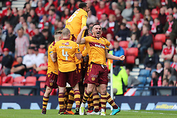 Motherwell's Tom Aldred celebrates after Curtis Main (hidden) scores his side's first goal of the game during the William Hill Scottish Cup semi final match at Hampden Park, Glasgow.