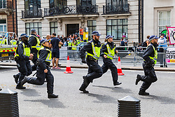 "Police rush towards trouble as several hundred far right protesters in central London demand the release of ""political prisoner"" right wing talisman Stephen Yaxley-Lennon  - also known as Tommy Robinson, who was imprisoned for contempt of court. London, August 03 2019."