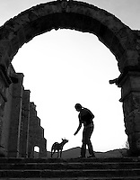 A young girl reaches out to a stray dog at the church in Yanhuitlan near Oaxaca, Mexico 2012