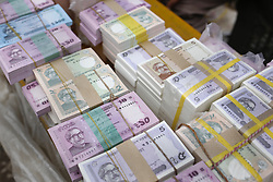 June 18, 2017 - Dhaka, Bangladesh - New money bundles are displaying for sell at a street vendor ashamed of Eid in the outcast of Dhaka. People give new money to a relative as a gift during Eid. (Credit Image: © Md. Mehedi Hasan via ZUMA Wire)