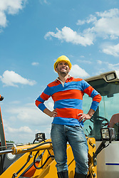 Construction worker on site with excavator