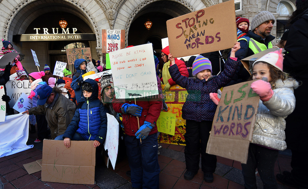 """December 10, 2016 - Washington, DC, USA - ELSIE KARLINS, 5 years old (far right) holds a sign saying ''Use Kind Words'' and ADELINE (ADDIE) WORSLEY, 5 years old, holds sign ''Stop Saying Mean Words'' as the group stand in front of hotel. Children's Rally for Kindness takes place at Trump International Hotel in Washington DC on December 10, 2016 organized by the Takoma Parents Action Coalition.  According to their FaceBook page, it was a call to President-elect Donald Trump: ''to remember these lessons as he prepares to take office and implement policies that will affect the lives of children and families across our diverse nation.''.''All over the world, across cultures and countries, children learn the same basic lessons: .Ã'be kind,Ã"""" .Ã'tell the truth,Ã"""" .Ã'be fair,Ã"""" .Ã'respect everyone,Ã"""" .Ã'treat others the way you want to be treated,Ã"""" .Ã'donÃ•t touch others if they donÃ•t want to be touched. (Credit Image: © Carol Guzy via ZUMA Wire)"""