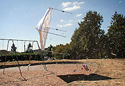 A shade canopy and straw fly over Coleman Playground, tossed airborne by a swirling wind that reminded observers of a small tornado.  No one was hurt; a camp at the Seattle Children's PlayGarden (cq) was in session at the time.