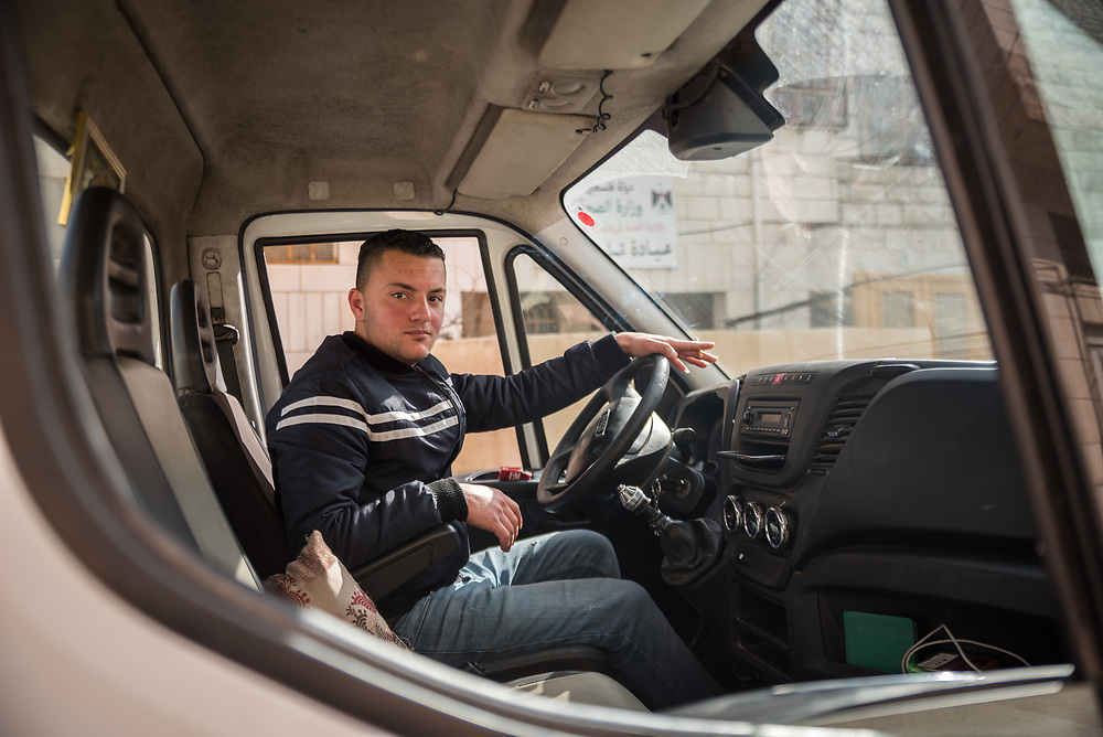 2 March 2020, Hebron: Palestinian man Odai drives a truck emptying garbage cans in the Tel Rumeida area of Hebron, West Bank.