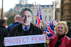 © Licensed to London News Pictures. 29/03/2019. London, UK. A man wearing a mask of Philip Hammond at the protest. Thousands of Leave campaigners outside Parliament protesting against the delay to Brexit, on the day the UK had been due to leave the European Union. British Prime Minister Theresa May's Brexit deal has been third defeat third time by a margin of 58 votes.Photo credit: Dinendra Haria/LNP