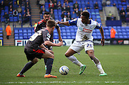 Tranmere Rovers' Jean-Louis Akpa Akpro looks to go past Carlisle United's David Symington. Skybet football league 1 match, Tranmere Rovers v Carlisle United at Prenton Park in Birkenhead, England on Saturday 29th March 2014.<br /> pic by Chris Stading, Andrew Orchard sports photography.