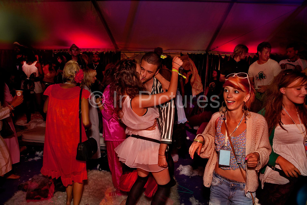 An intoxicated couple dance at Hotel Slumbarave. Hotel Slumbarave metropolis offers clientel a place to chill, slumber or have a pillow fight!.Shangri-la, Glastonbury Festival 2010