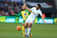 Neil Taylor of Swansea city is tackled by Nathan Redmond (l) of Norwich city. Barclays Premier league match, Swansea city v Norwich city at the Liberty Stadium in Swansea, South Wales  on Saturday 5th March 2016.<br /> pic by  Andrew Orchard, Andrew Orchard sports photography.