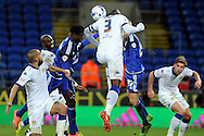 Leeds United's Sol Bamba (3) heads away under pressure from a corner. Skybet football league championship match, Cardiff city v Leeds Utd at the Cardiff city stadium in Cardiff, South Wales on Tuesday 8th March 2016.<br /> pic by Carl Robertson, Andrew Orchard sports photography.