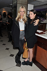 Left to right, POPPY DELEVINGNE and TALLULAH HARLECH at a party hosted by TopShop to celebrate 10 years of NEWGEN and 10 years of supporting Brtish Fashion held at Le Baron, 29 Old Burlington Street, London W1 on 21st February 2012.