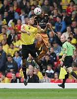 Photo: Lee Earle.<br /> Watford v Wolverhampton Wanderers. Coca Cola Championship. 29/10/2005. Watford's Clarke Carlisle (L) battles in the air with Leon Clarke.