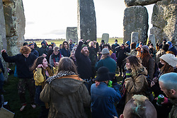 Around two hundred people, including local residents, climate and land justice activists and pagans, take part in a Mass Trespass at Stonehenge on 5th December 2020 in Salisbury, United Kingdom. The trespass was organised in protest against the approval by Transport Secretary Grant Shapps of a £1.7bn project for a two-mile tunnel beneath the World Heritage Site and a further eight miles of dual carriageway for the A303, as well as the government's £27bn Road Investment Strategy 2 (RIS2).